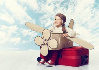 bigstock-Little-Child-Playing-Airplane-85445417-500x354